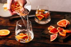 Free Pouring Infused Water With Oranges Into The Glass Royalty Free Stock Photo - 149325735