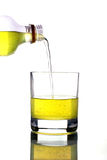Pouring juice into cup Stock Photography