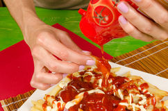 Pouring ketchup Royalty Free Stock Photo