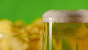 Pouring lager beer in a mug stock footage