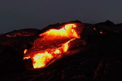 Pouring lava on the slope of the volcano. Volcanic eruption and magma. Pouring lava on the slope of the volcano. Volcanic eruption and magma Royalty Free Stock Photos