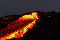 Pouring lava on the slope of the volcano. Volcanic eruption and magma. Pouring lava on the slope of the volcano. Volcanic eruption and magma Royalty Free Stock Images