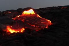 Pouring lava on the slope of the volcano. Volcanic eruption and magma. Pouring lava on the slope of the volcano. Volcanic eruption and magma Stock Photos