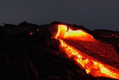 Pouring lava on the slope of the volcano. Volcanic eruption and magma. Pouring lava on the slope of the volcano. Volcanic eruption and magma Stock Image