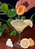 Pouring a Lemon Drop martini Royalty Free Stock Photography