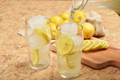 Pouring lemonade Stock Image