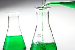 Pouring liquid chemicals Royalty Free Stock Photo