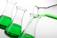 Pouring liquid chemicals Royalty Free Stock Images