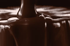 Pouring liquid hot chocolate closeup. Cooking dessert. Royalty Free Stock Photo