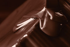 Pouring liquid hot chocolate closeup. Cooking dessert. Stock Photography