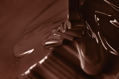 Pouring liquid hot chocolate closeup. Cooking dessert. Pouring liquid hot chocolate from above closeup. Cooking dessert Royalty Free Stock Image