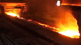 Pouring of liquid metal from blast furnace stock footage