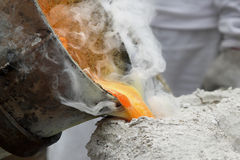 Pouring liquid metal into mold. For casting metal royalty free stock images