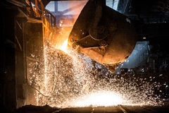 Pouring of liquid metal in open-hearth furnace. Foundry royalty free stock image