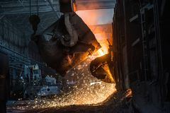 Pouring of liquid metal in open-hearth furnace.  stock photography
