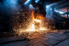 Pouring of liquid metal in open-hearth furnace Stock Photography