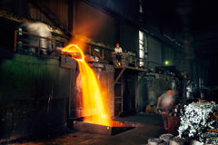 Pouring of liquid metal in open hearth workshop Royalty Free Stock Image