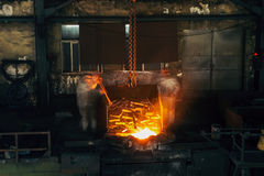 Pouring of liquid metal in open hearth workshop Royalty Free Stock Photos