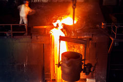 Pouring of liquid metal in open hearth workshop Stock Photography
