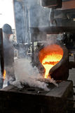 Pouring of liquid metal. In open hearth workshop stock photography
