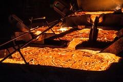 Pouring liquid titanium slag from arc furnace Stock Photography