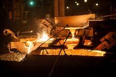 Pouring liquid titanium slag from arc furnace Royalty Free Stock Photos