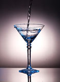 Pouring liquor into a martini glass Royalty Free Stock Images