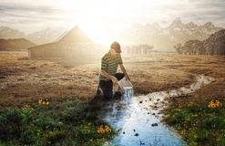 Pouring living water into a stream Royalty Free Stock Photo