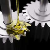 Pouring Lube on Gearwheels 3d Illustration. Pouring Lube on Gearwheels Closeup 3d Illustration Stock Photography