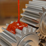 Pouring Lubricant on Gears 3d Illustration. Pouring Lubricant on Gears Closeup 3d Illustration Stock Photos