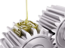 Pouring Lubricant on Gearwheel Closeup 3d Illustration. On White Background Royalty Free Stock Photography