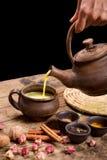 Pouring masala tea from pot Royalty Free Stock Photos