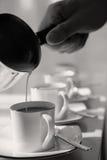 Pouring milk - black and white stock photos