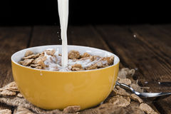 Pouring Milk in a bowl with Cornflakes Royalty Free Stock Photography