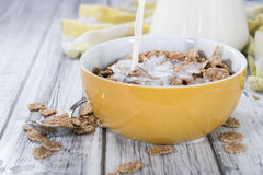 Pouring Milk in a bowl with Cornflakes Stock Image