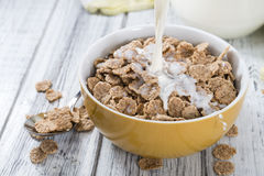 Pouring Milk in a bowl with Cornflakes Stock Photography