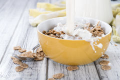 Pouring Milk in a bowl with Cornflakes Stock Photos