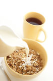 Pouring milk into breakfast cereal - high key Stock Image