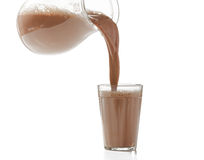 Pouring milk chocolate into a glass Stock Photos