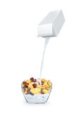 Pouring milk into cornflakes bowl Royalty Free Stock Images