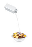 Pouring milk into cornflakes bowl Stock Images