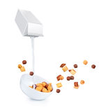 Pouring milk into cornflakes bowl Stock Photos