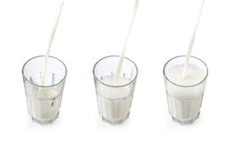 Pouring milk in a glass Royalty Free Stock Image