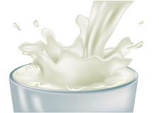 Pouring milk Stock Images