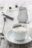 Pouring milk from jug cup black coffee Royalty Free Stock Photos