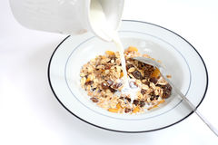 Pouring milk on muesli Stock Photography