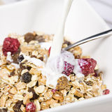 Pouring milk into muesli Royalty Free Stock Image