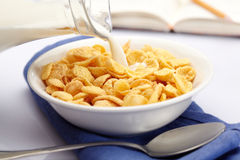 Pouring milk over cornflakes Royalty Free Stock Photo