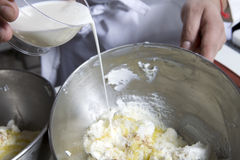 Pouring milk in pastry Stock Photos