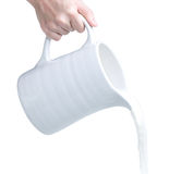 Pouring milk from pitcher Royalty Free Stock Photo